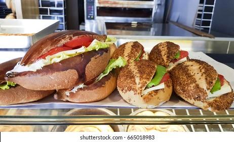 Turkish Cold Sandwich with sliced tomato, feta cheese, salt and hot green pepper. Izmir Kumru.