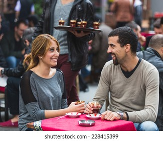 Turkish Couple Drinking Cay, Traditional Tea, in Istanbul. Cay is served in small glasses and People drink it everytime during the day.