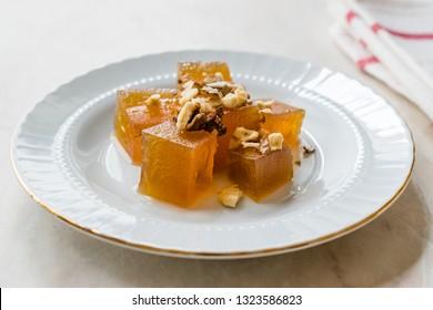 Turkish Crispy Pumpkin Dessert from Hatay / Kirecte Kabak Tatlisi with Walnut Powder.