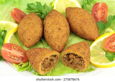 Turkish cuisine, bulgur coated meatballs  - ( icli kofte )