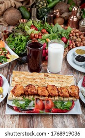 Turkish cuisine chicken skewer. Traditional grilled chicken Shish Kebab or Shish Tawook on skewers. Close up with copy space.