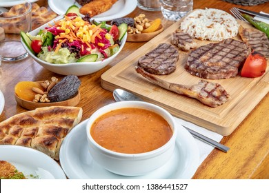 Turkish cuisine; It's also Ramadan 'Iftar'.The meal eaten by Muslims after sunset during Ramadan. Assorted of Turkish oriental dishes. Grilled mixed meat in restaurant.