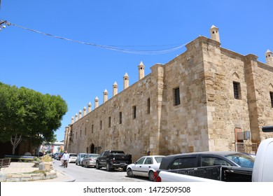 Turkish Cyprus - May 8, 2019: exterior of  an ex caravanserai realized in 1700 with typical architectural ottoman style today it houses shops and inn