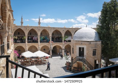 Turkish Cyprus - May 8, 2019: people visiting kumarcilar Inn in Nicosia an ex caravanserai realized in 1700 with typical architectural style apt to host the caravans that passed