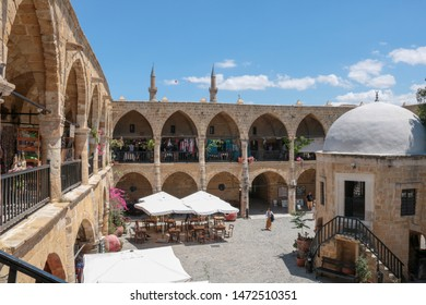 Turkish Cyprus - May 8, 2019: tourists visiting kumarcilar Inn in Nicosia an ex caravanserai realized in 1700 with typical architectural style apt to host the caravans that passed