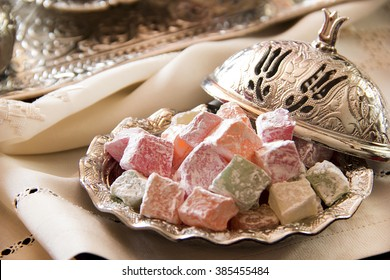 Turkish delight with coffee and traditional silver serving set
