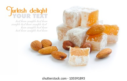 Turkish delight (lokum) with nuts on white background