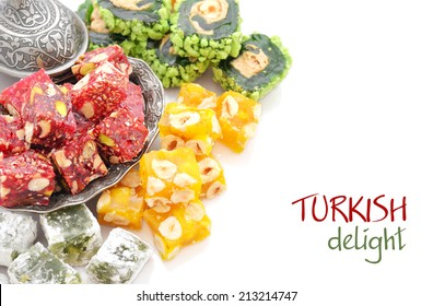 Turkish delight on oriental metal plate isolated on white background