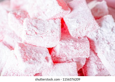 Turkish delight on white wooden table.
