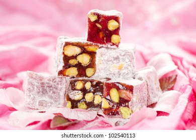 turkish delight with pistachios nut in glitter pink and rose petals