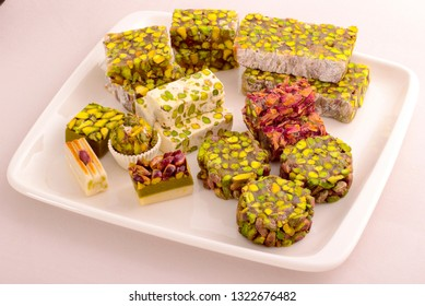 Turkish delight are small, fragrant cubes of jelly, usually flavoured with rosewater, orange flower water or citrus fruit juice and heavily dusted with icing sugar ,Turkish delight