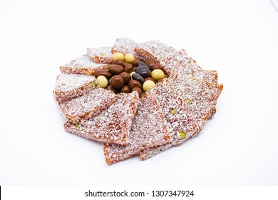 Turkish delight, Special Mersin lokum with carrot, pistachio and coconuts on white backgroun. Special Mersin delight with chocolate in the middle.