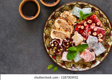 Turkish Delight. Traditional Turkish sweets. Loukum and coffee on a dark background.