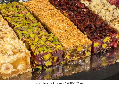Turkish delight types with dried fruits and dried fruits on a black background