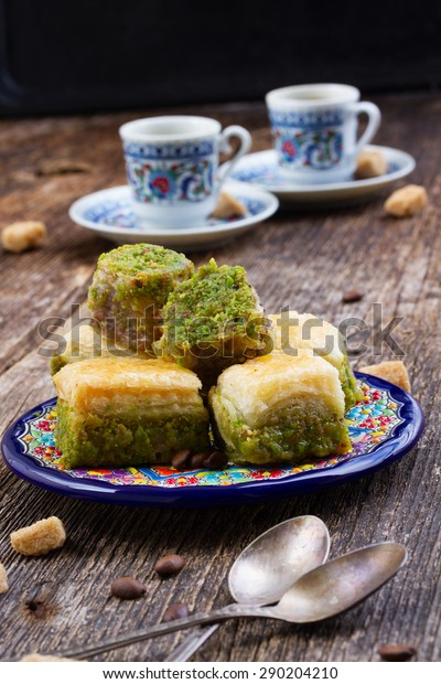 turkish delights - baklava sweets  with two cups of coffee