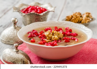 Turkish dessert Ashura, Noah's pudding, with pomegranate seeds and walnuts