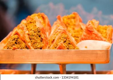 Turkish dessert baklava ( Aslan Agzi ) with pistachio nuts