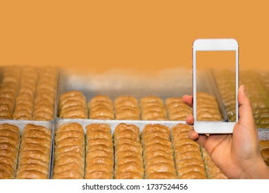 Turkish dessert baklava concept background order with mobile phone