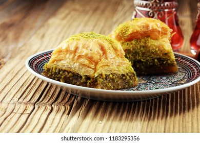 Turkish Dessert Baklava with pistachio on wooden table