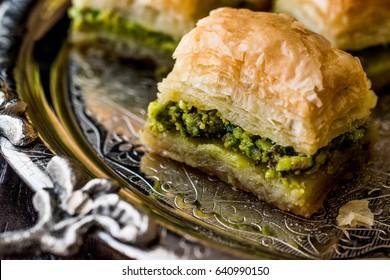Turkish Dessert Baklava with pistachio on silver tray.