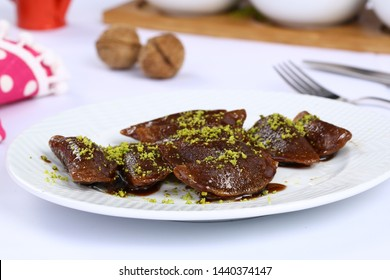 Turkish dessert chocolate baklava - Muska baklava - The triangle shaped baklava - Shutterstock ID 1440374147