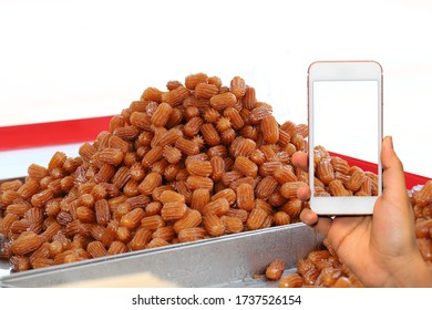 Turkish dessert concept background order with mobile phone