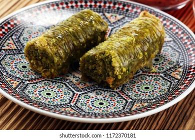 Turkish Dessert fıstık ezmesi baklava with pistachio on wooden table