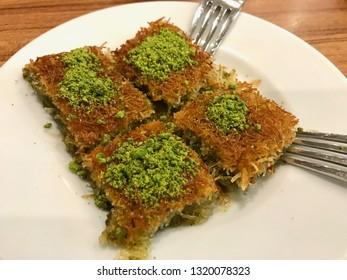 Turkish Dessert Kadayif with pistachio powder (traditional dessert with powdered pistachio)