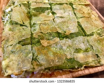Turkish Dessert Katmer with Pistachio Powder from Gaziantep Region / Prepared with Crispy Thin Dough and Clotted Cream Cheese.