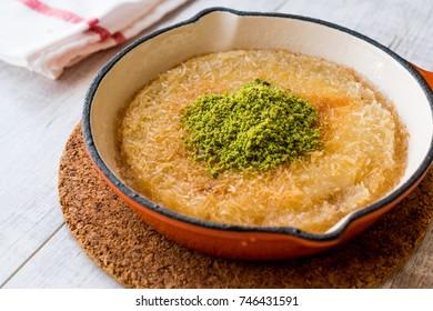 Turkish Dessert Kunefe with Pistachio Powder.