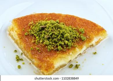 turkish dessert kunefe , slide with pistachio powder