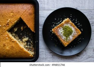 Turkish Dessert Revani with pistachio powder.