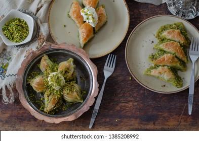 Turkish Dessert Sobiyet Baklava, mussels baklava and classic baklava with Pistachio / Fistikli Baklava, top view.