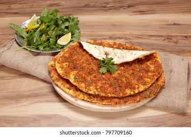 Turkish dishes: lahmacun, turkish pizzas, lemon, parsley