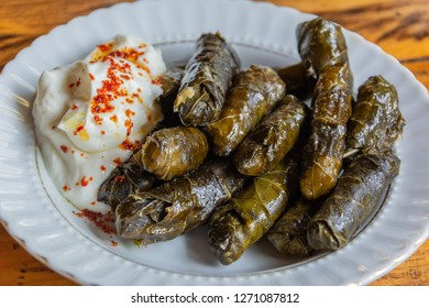 Turkish dolma - vine leaves stuffed with meat, with yoghurt.