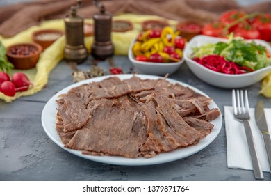 Turkish Doner Kebab on plate. Arabic traditional doner with pita bread / lavash. Protein nutrition, clean eating, diet concept. Turkish, greek or middle eastern style doner kebab food restaurant.
