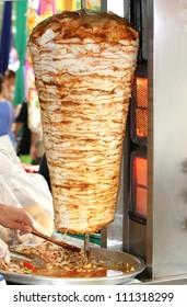 Turkish doner kebab in a restaurant in istanbul . ( chicken doner kebab )