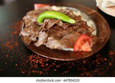 Turkish Doner Kebab with rice on the dinner plate.