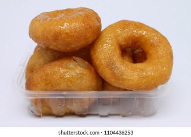 turkish donut ( lokma ) on the plate isolated