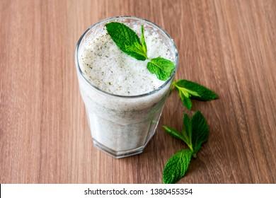 Turkish Drink Ayran or Kefir with fresh herbs in a glass. Buttermilk made with yogurt. (yogurt, youghurt, kefir, ayran, lassi)