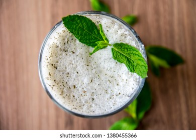 Turkish Drink Ayran or Kefir with fresh herbs in a glass. Buttermilk made with yogurt. (yogurt, youghurt, kefir, ayran, lassi)