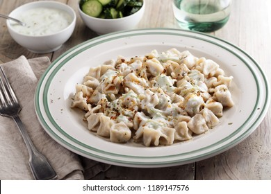 Turkish dumplings Manti with tzatziki, cucumbers, and spices