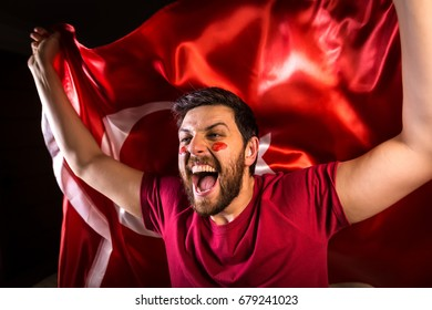 Turkish fan holding the national flag