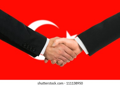 The Turkish flag and business handshake