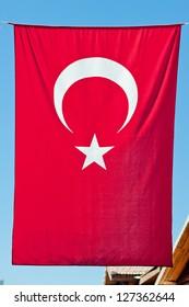 Turkish flag hanging vertically.
