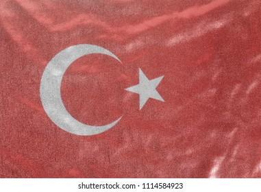 Turkish flag on fabric background close up .