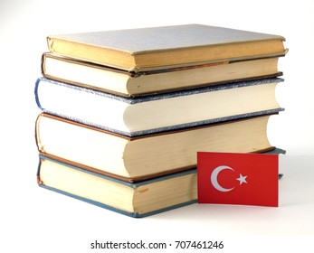 Turkish flag with pile of books isolated on white background
