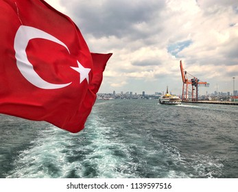 turkish flag waving against sea in Istanbul, Turkey
