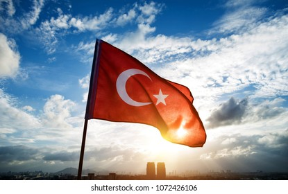 Turkish flag waving on sky