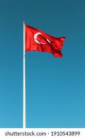 Turkish flag waving in the sky. crescent star flag. red white flag. Turkey. 23 nisan ulusal egemenlik ve çocuk bayramı.  23 april. 19 may. 19 Mayıs Atatürk'ü Anma, Gençlik ve Spor Bayramı Türkiye
